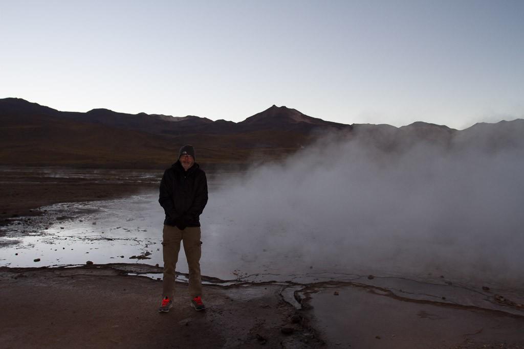 Warming Up next to a Geyser, Geyser del Tatio, Atacama, Chile