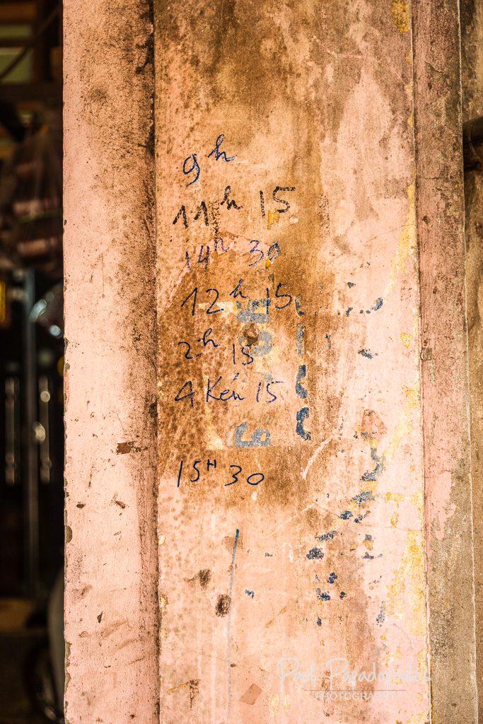 Train timetable - Life along the train tracks - Hanoi, Vietnam