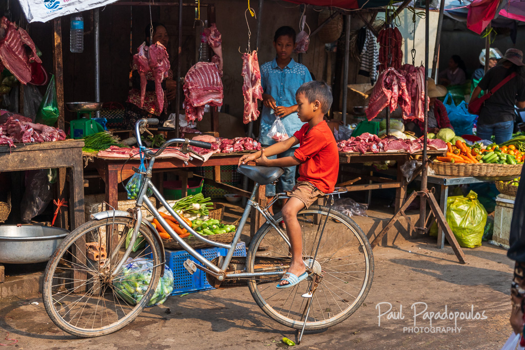 Kid at the market - Siem Reap, Cambodia