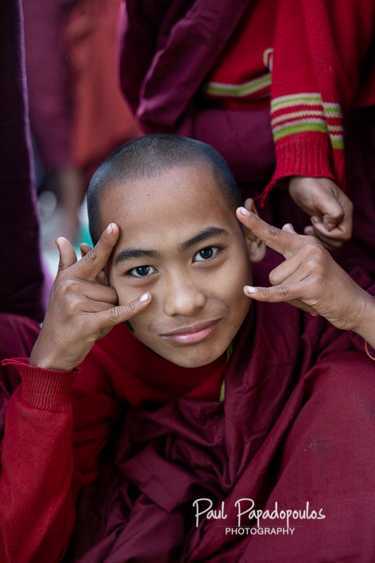Young monk making fun of tourists - Ananda Festival - Bagan, Myanmar